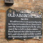 The historic plaque displayed at the entrance of the Old Absinthe House