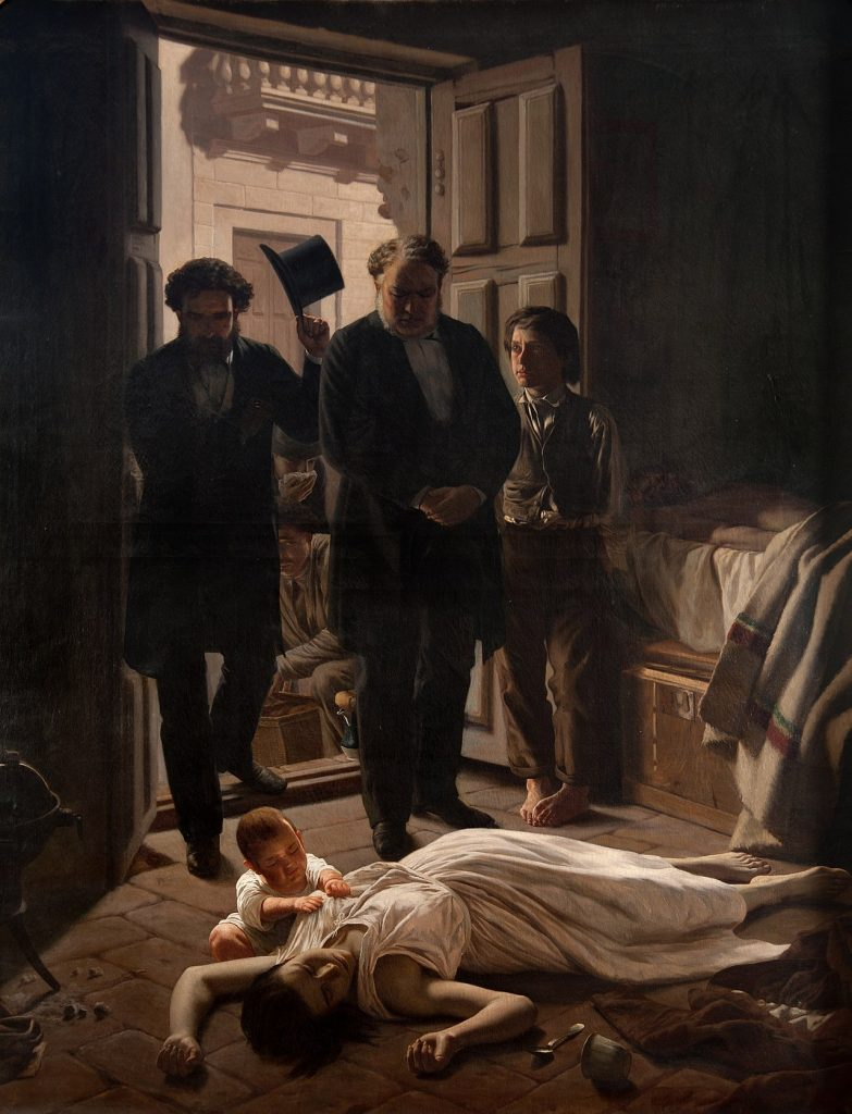 A woman laying on the floor while being attended by three men