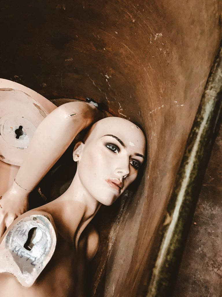 dismembered wax dummy in a tub