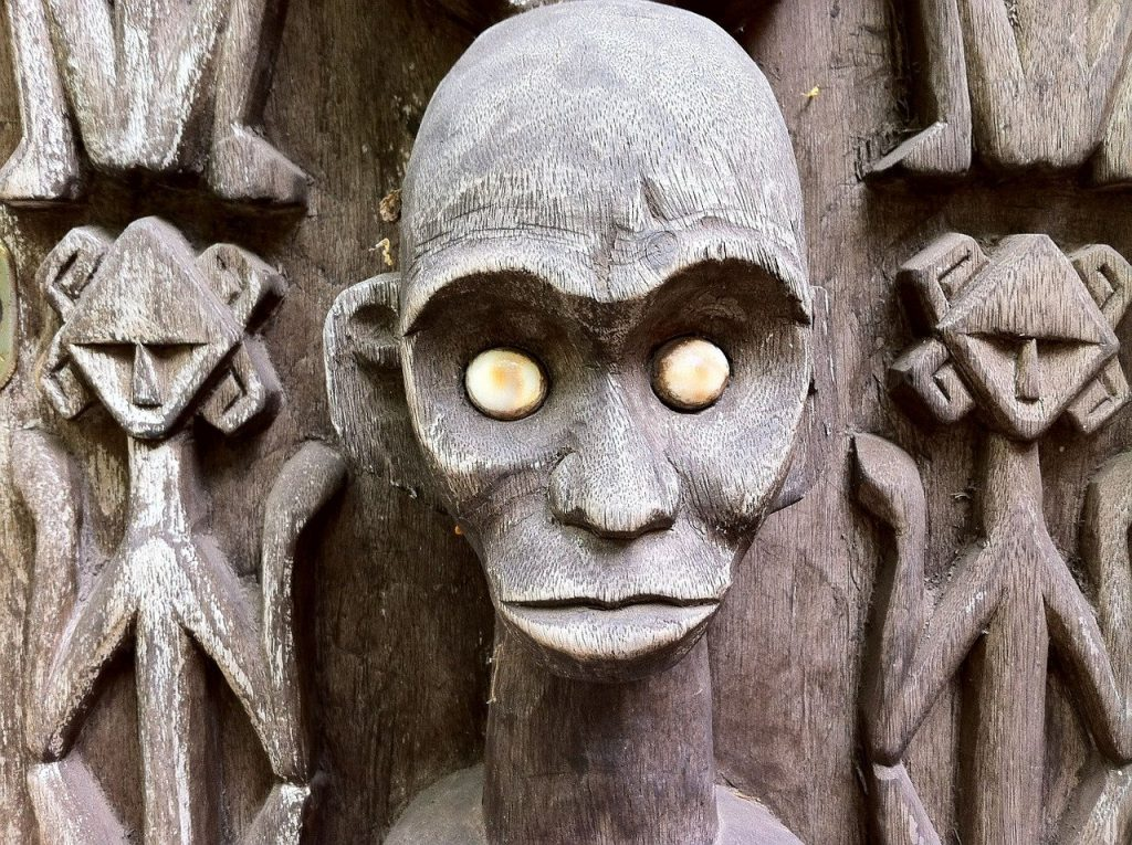 African Sculpture showinf glowing pearl eyes