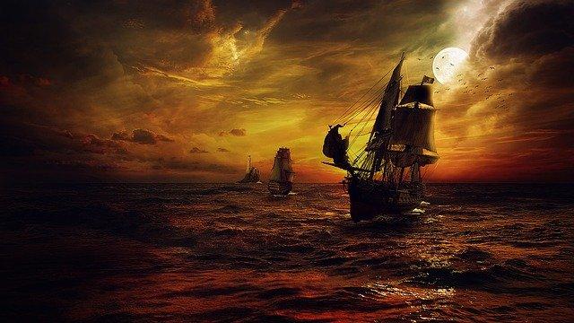 Warship against an orange sunset